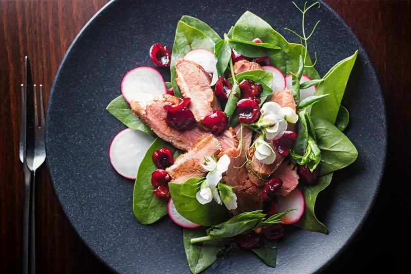 Here's How to Make Duck Salad with Balsamic Cherries
